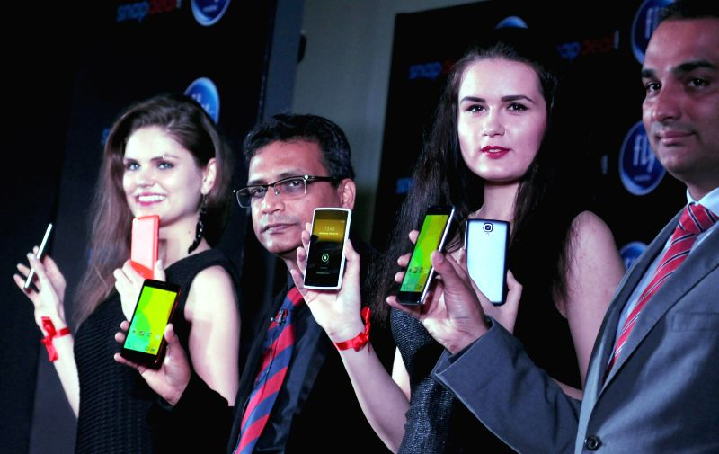 Models launch Fly smartphone in New Delhi, on Feb 25, 2015.