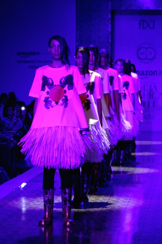 Models showcase creations of fashion designer Amit Aggarwal during Amazon India Fashion Week in New Delhi, on March 26, 2015.
