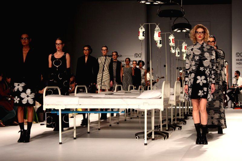Models showcase fashion designer Rajesh Pratap Singh's creations during Amazon India Fashion Week in New Delhi, on March 25, 2015.