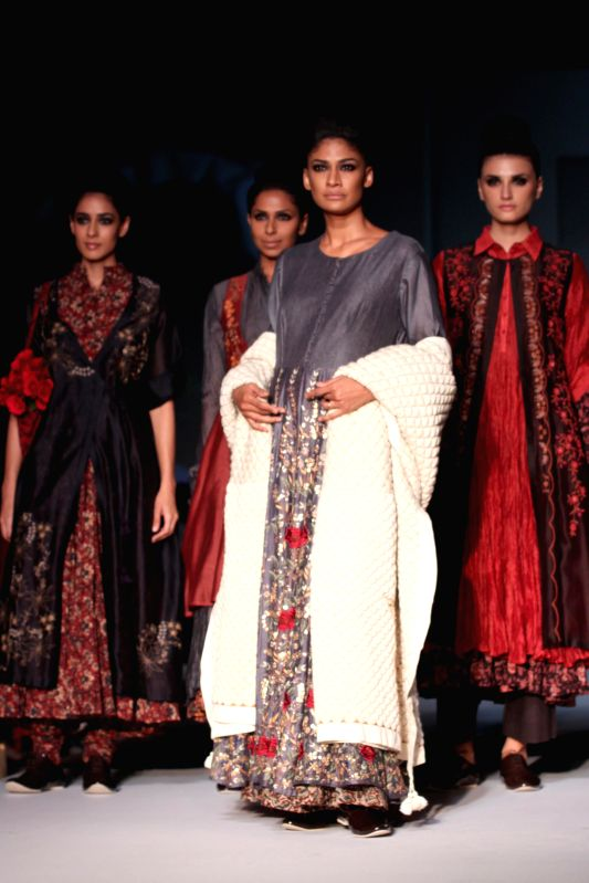 Models showcases fashion designer Pratima Pandey`s creations during Amazon India Fashion Week in New Delhi, on March 28, 2015.