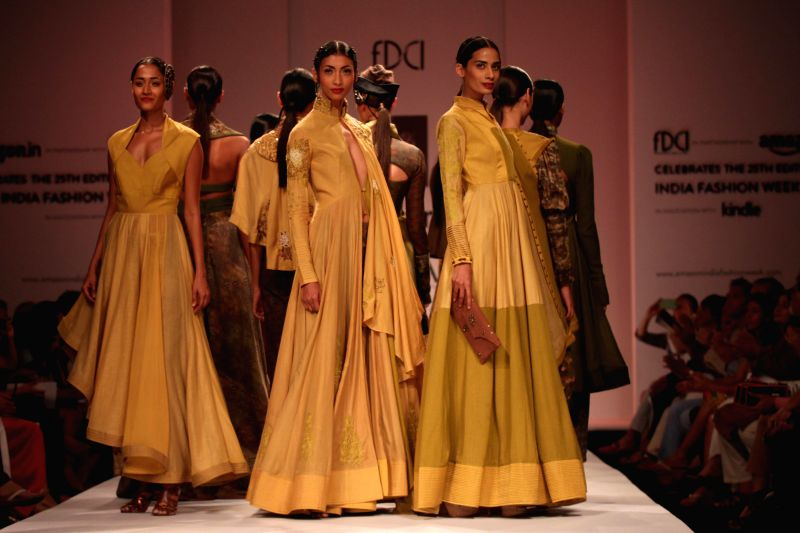 Models showcases fashion designer trio Ashish, Viral and Vikrant`s creations during Amazon India Fashion Week in New Delhi, on March 28, 2015.