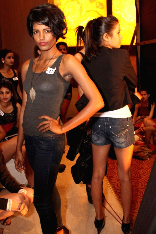Models wait for their turn during the auditions for upcoming India Fashion Week Autumn Winter 2015, in New Delhi on Feb 18, 2015.