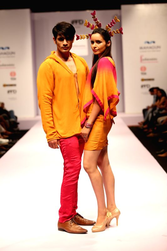 Models walk the ramp during India Runway Week in New Delhi, on April 12, 2015.