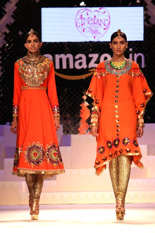 Models walk the ramp during The Grand Finale of Amazon India Fashion Week 2015 in New Delhi on March 29, 2015.