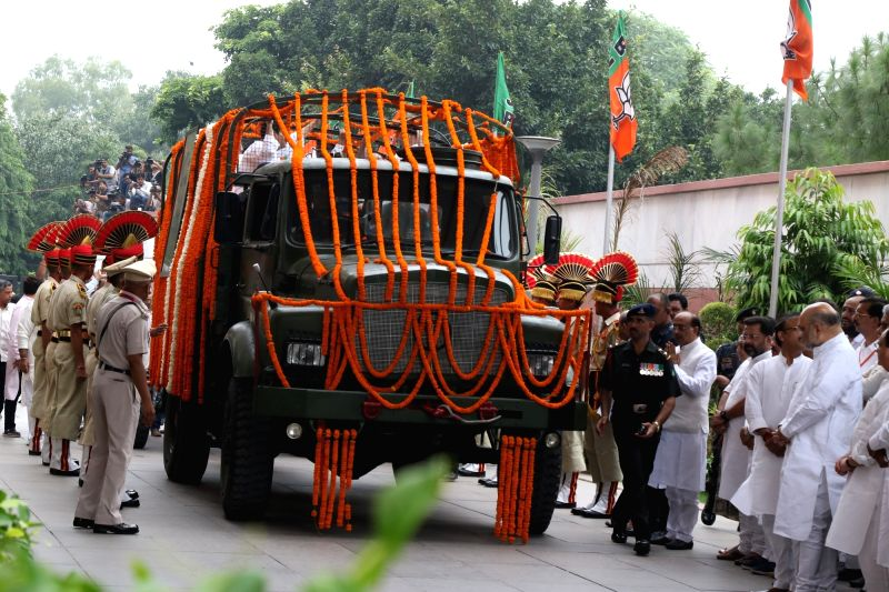 New Delhi: Mortal remains of late BJP leader Arun Jaitley arrives at party headquarters in New Delhi on Aug 25, 2019.