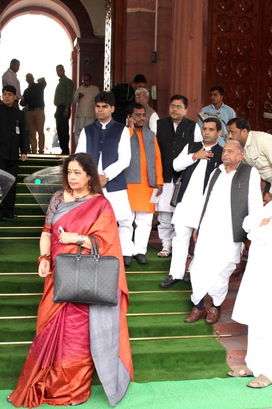 MPs including Samajwadi Party chief Mulayam Singh, actor turned politician Kirron Kher at the Parliament on the second day of the budget session in New Delhi, on Feb 24, 2015. - Mulayam Singh and Kirron Kher