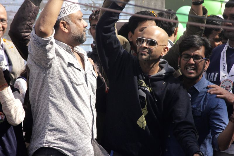 MTV Roadies executive producer Raghu Ram celebrate Aam Aadmi Party (AAP)party`s performance in the recently concluded Delhi Assembly Polls at Patel Nagar in New Delhi, on Feb 10, 2015.