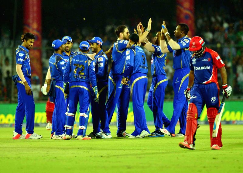 Mumbai Indians celebrate fall of a wicket during an IPL-2015 match between Delhi Daredevils and Mumbai Indians at Feroz Shah Kotla stadium, in New Delhi, on April 23, 2015. - Feroz Shah Kotla