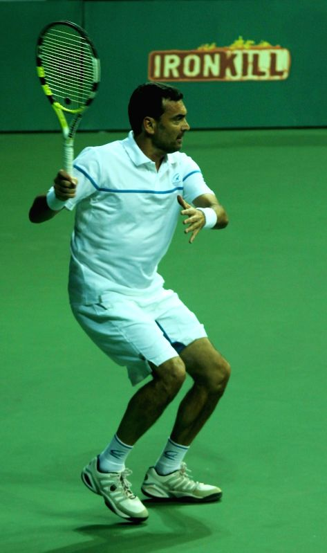 Mumbai player Sergi Burguera  in action against Delhi player Juan Carlos Ferrero during a Champions Tennis League  (CTL) match at R.K. Khanna Tennis Stadium in New Delhi, on Nov 18, 2014.