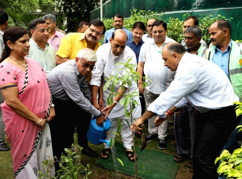 New Delhi Municipal Council (NDMC) tree plantation campaign in New Delhi on Aug 5, 2017. Also seen NDMC Chairman Naresh Kumar. - Naresh Kumar