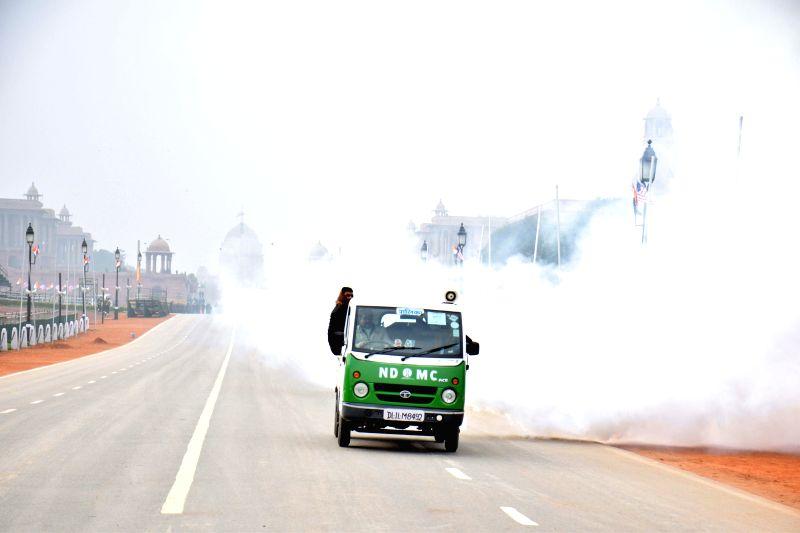 Municipal workers fumigating areas near Rajpath in New Delhi on Jan. 24, 2015.