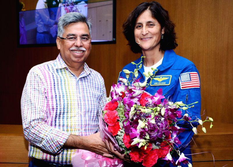 NASA Astronaut Capt. Sunita Williams meets Hero MotoCorp CEO and Managing Director Pawan Munjal during her India in New Delhi, on April 22, 2015.