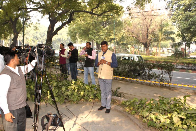 National Media covering Delhi`s Chief Minister-designate Arvind Kejriwal and Prime Minister Narendra Modi`s meeting from a distance, near  PM`s residence, in New Delhi on Feb 12, 2015. - Narendra Modi