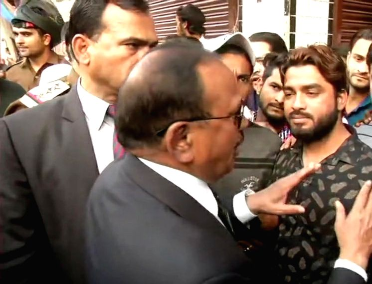 New Delhi: National Security Advisor Ajit Doval interacts with locals as he toured the violence-hit areas of Northeast Delhi, in New Delhi on Feb 26, 2020. (Photo: IANS)