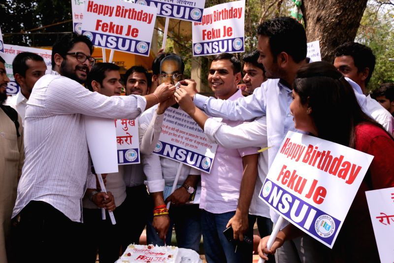 National Students' Union of India (NSUI) activists stage a demonstration against Prime Minister Narendra  Modi in New Delhi, on April 1, 2015. - Narendra
