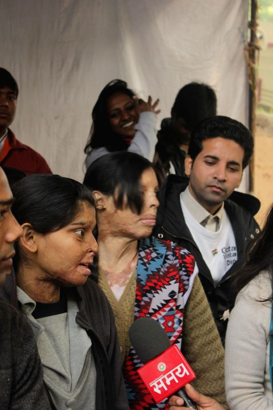 Nationalist Congress Party (NCP) youth wing with acid attack survivors stage a demonstration at Jantar Mantar in New Delhi, on Dec 27, 2014.