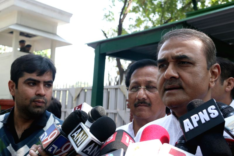 NCP leader Praful Patel talks to press outside the residence of former prime minister Manmohan Singh in New Delhi, on March 17, 2015.