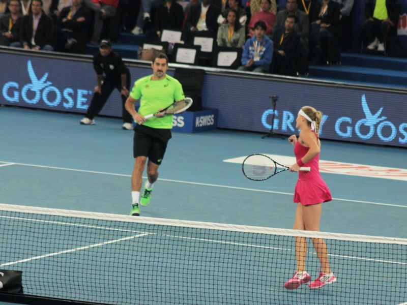 Nenad Zimonjic and Kristina Mladenovic of UAE Royals during a match against Indian Aces players Roger Federer and Sania Mirza during a mixed doubles IPTL match at Indira Gandhi Indoor ... - Sania Mirza