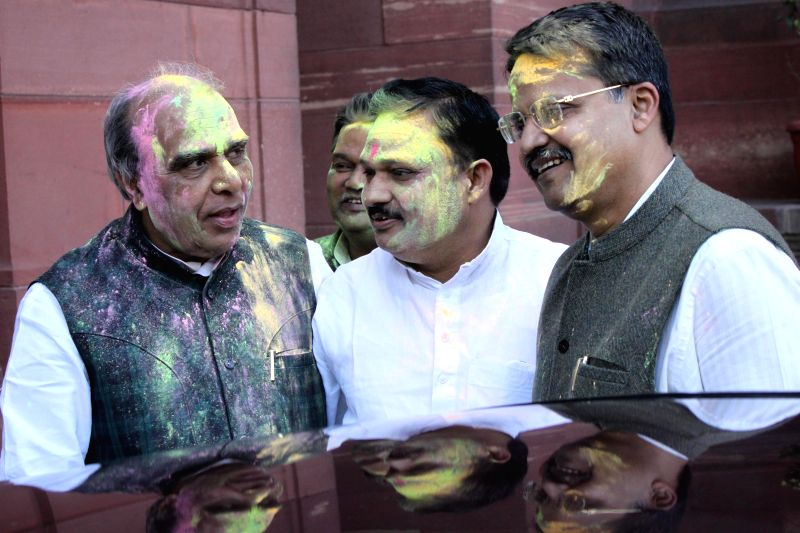 New Delhi: Parliamentarians celebrate Holi at the Parliament in New Delhi, on March 4, 2015. Also seen Kirron Kher. - Kirron Kher
