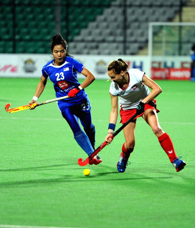 New Delhi: Players of the women team of India and Thailand in action during a match of FIH Hockey World League Round 2 (Women) at Major Dhyan Chand National Stadium in New Delhi on March ...