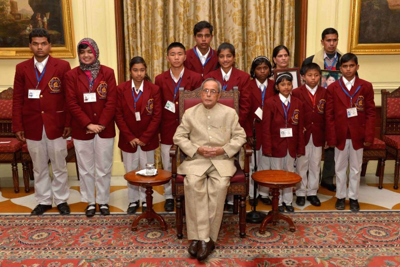New Delhi: President Pranab Mukherjee with the winners of the National Bravery Awards-2014, at Rashtrapati Bhavan, in New Delhi on Jan 22, 2015. - Pranab Mukherjee