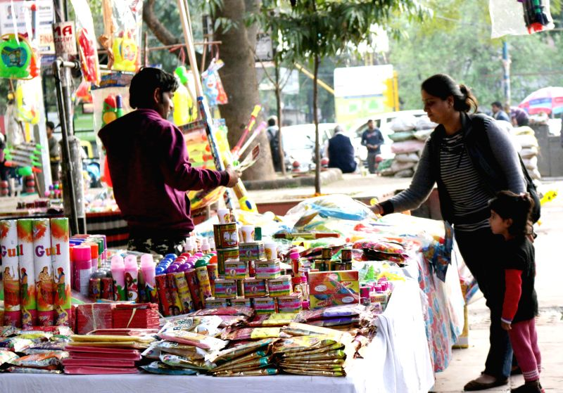 New Delhi: Small time businessmen setup their stalls ahead of Holi in New Delhi  on March 3, 2015.