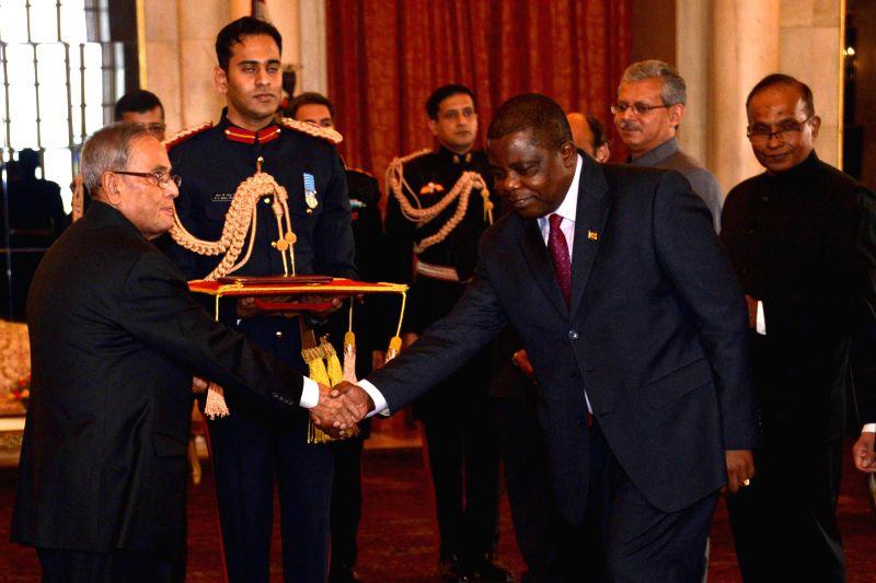 New Delhi: The Ambassador-designate of Zimbabwe Maxwell Ranga presents his credential to President Pranab Mukherjee at Rashtrapati Bhavan, in New Delhi on Jan 16, 2015. - Pranab Mukherjee