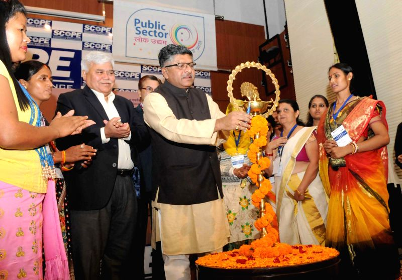 New Delhi: The Union Minister for Communications and Information Technology Ravi Shankar Prasad lights the lamp to inaugurate the First All Women Village Level Entrepreneur Conference, in ...