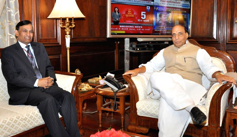 New Union Home Secretary L.C. Goyal calls on the Union Home Minister Rajnath Singh, in New Delhi on Feb 5, 2015.