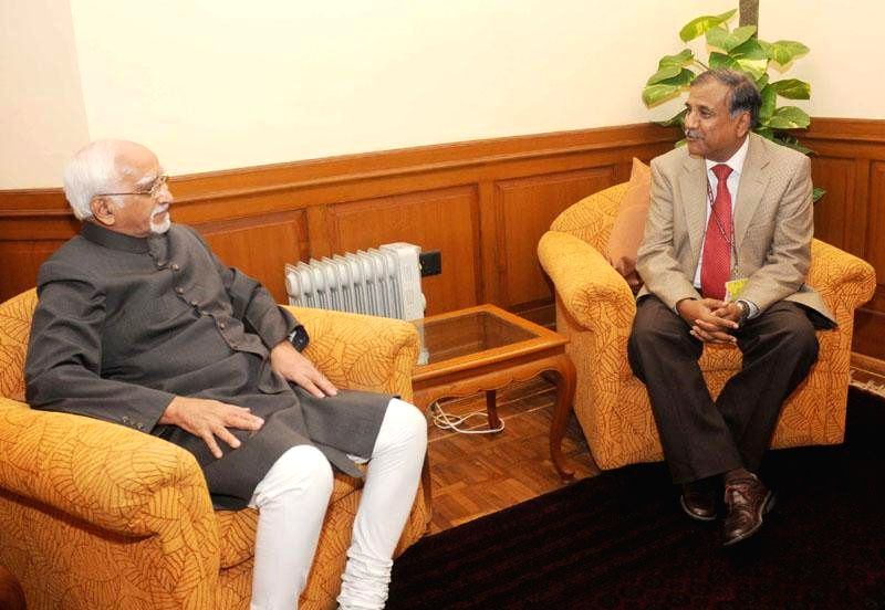 Newly appointed Chairman of Union Public Service Commission Deepak Gupta calls on Vice-President Mohammad Hamid Ansari, in New Delhi on Dec 2, 2014.