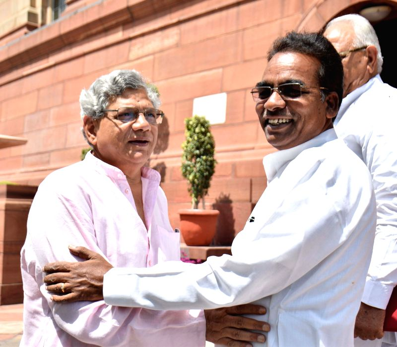 Newly elected CPI(M) General Secretary Sitaram Yeachury with Congress leader JD Seelam at Parliament house in New Delhi on April 23, 2015.