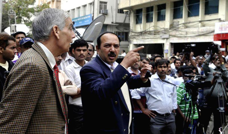 NIA officers visit the site of Dec 28 low intensity blast that rocked Bengaluru's Church street, on Dec 29, 2014.