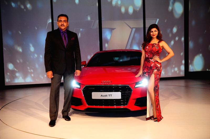 Nimrat Kaur and Indian Cricket Team Director Ravi Shastri during the launch of third generation Audi TT in New Delhi, on April 23, 2015. - Nimrat Kaur