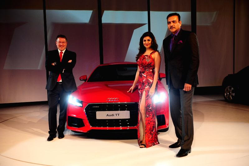 Nimrat Kaur, Indian Cricket Team Director Ravi Shastri, Audi India Head Joe King during the launch of third generation Audi TT in New Delhi, on April 23, 2015. - Nimrat Kaur