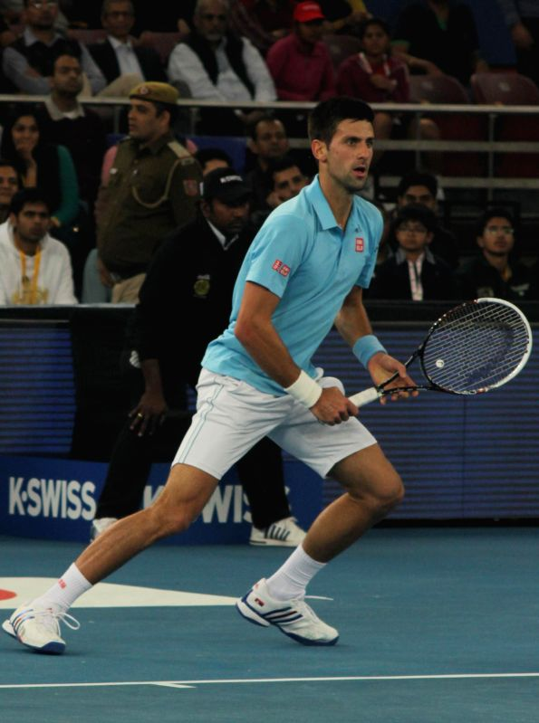 Novak Djokovic of UAE Royals in action against Indian Aces player Roger Federer during a mens' singles IPTL match at Indira Gandhi Indoor Arena in New Delhi, on Dec 8, 2014. Federer won. ..