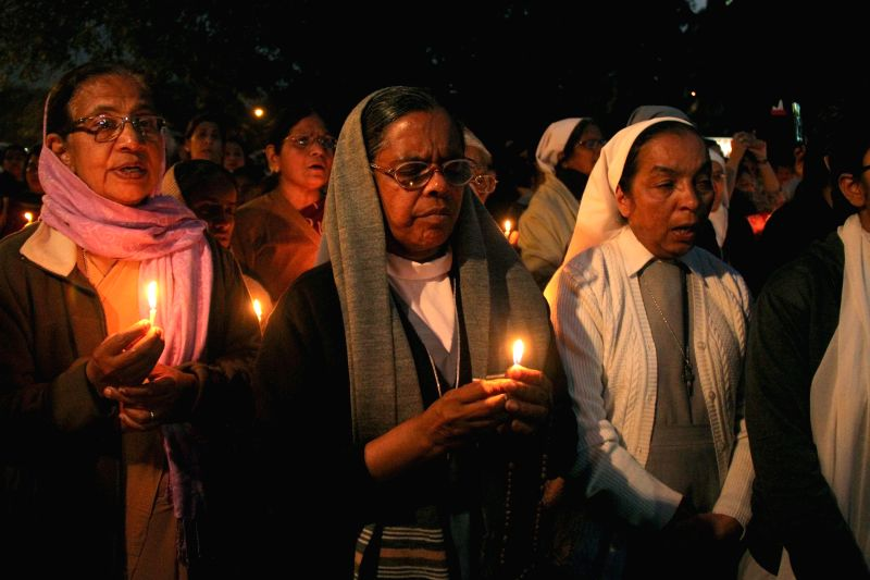 Nuns hold a candlelight vigil against the recent gang rape of a nun in Ranaghat of West Bengal's Nadia district, in New Delhi, on March 16, 2015.
