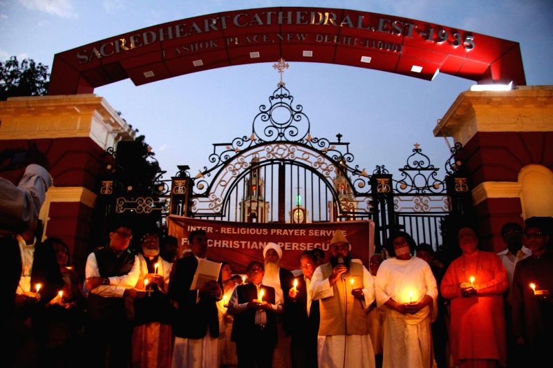 Nuns hold a candlelight vigil to condemn the recent attack on an under-construction church in Haryana and the  gang rape of a nun in Ranaghat of West Bengal's Nadia district, in New Delhi, ...