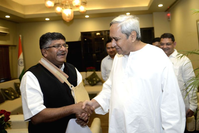 Odisha Chief Minister Naveen Patnaik calls on the Union Minister for Communications and Information Technology Ravi Shankar Prasad, in New Delhi on April 10, 2015. - Naveen Patnaik