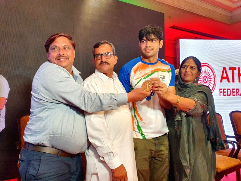 New Delhi : Olympic gold medalist Neeraj Chopra with parents during a press conference in New Delhi on Tuesday, August 10, 2021.(Photo: Anupam Gautam/IANS)