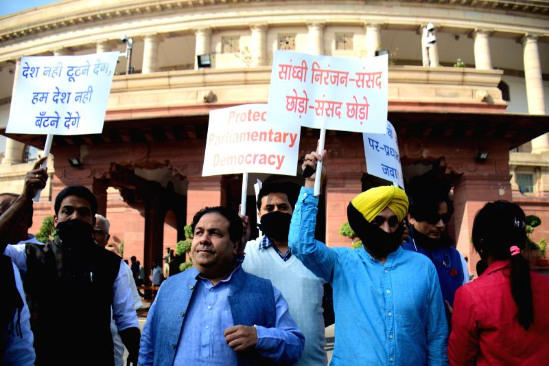 Opposition leaders including Congress MP Rajiv Shukla and AAP MP Bhagwant Mann stage a demonstration against the Union MoS Food Processing Industries Sadhvi Niranjan Jyoti at the ...