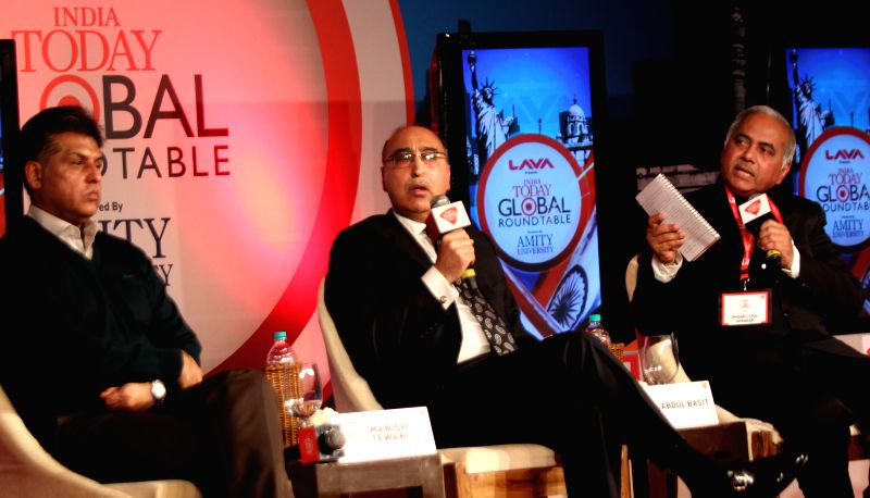 Pakistan High Commissioner to India Abdul Basit with Manish Tiwari and BJP leader and Editor of AGNI Seshadri Chari during a Round Table organised by India Today Group in New Delhi, on Jan
