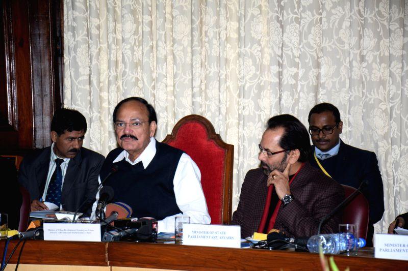 Parliamentary Affairs Minister M Venkaiah Naidu with Union Minister of State for Parliamentary Affairs Mukhtar Abbas Naqvi during a press conference in New Delhi, on Dec 23, 2014. - M Venkaiah Naidu