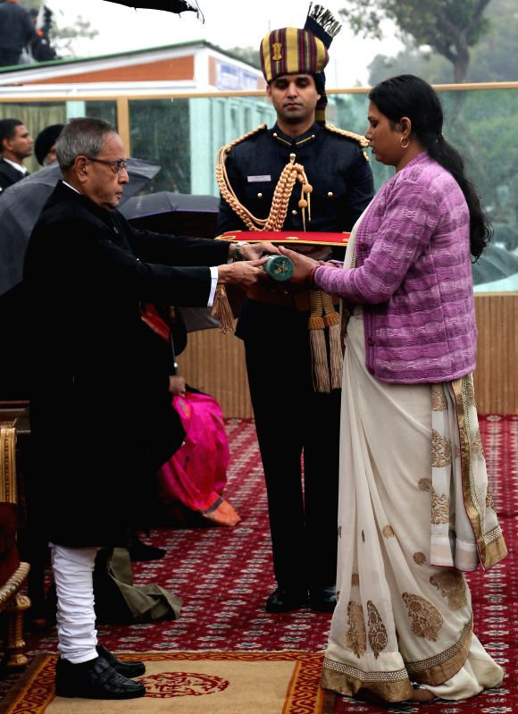 Parmeshwari Devi, the wife of late Naik Neeraj Kumar Singh receives the nation's highest peacetime gallantry award, the Ashoka Chakra from President Pranab Mukherjee  on Republic Day in ... - Pranab Mukherjee