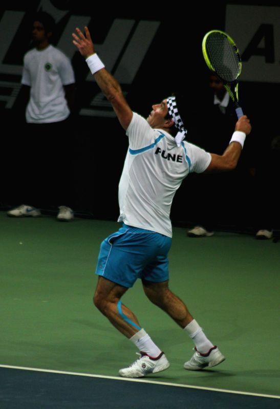 Pat Cash of of Pune during Champions Tennis League (CTL) final match against Juan Carlos Ferrero of Delhi at R.K. Khanna Tennis Stadium in New Delhi, on Nov 26, 2014.