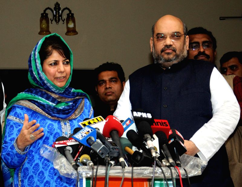 PDP leader Mehbooba Mufti and BJP chief Amit Shah talk to press regarding government formation in  Jammu and Kashmir, in New Delhi, on Feb 24, 2015.