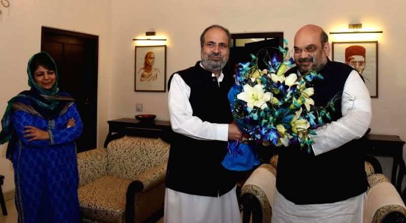 PDP leader Muzaffar Hussain Baig with BJP chief Amit Shah during a meeting with BJP chief Amit Shah regarding government formation in  Jammu and Kashmir, in New Delhi, on Feb 24, 2015. ...