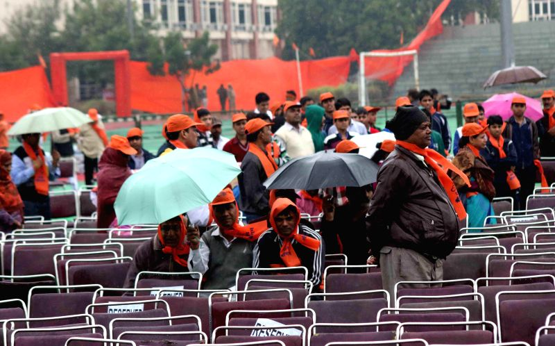 People brave rains to participate in VHP's Virat Hindu Sammelan organised at Jawaharlal Nehru Stadium of New Delhi, on March 1, 2015.
