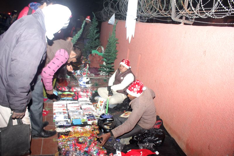 People busy shopping on the eve of Christmas at Gol Dak Khana Church in New Delhi on Dec 24, 2014.