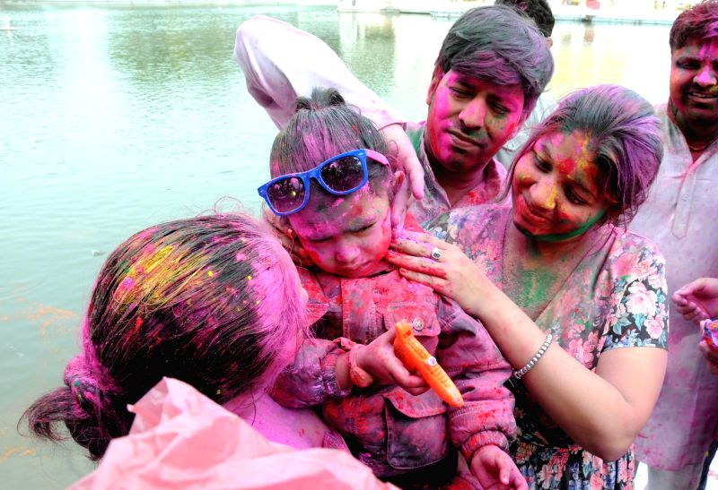 People celebrate Holi at the Durgiana Temple in New Delhi, on March 5, 2015.