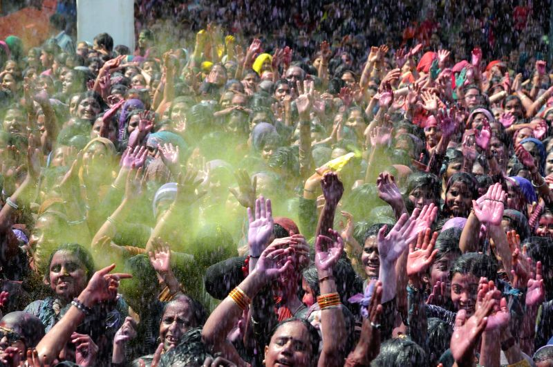 People celebrate Holi in New Delhi on March 5, 2015.